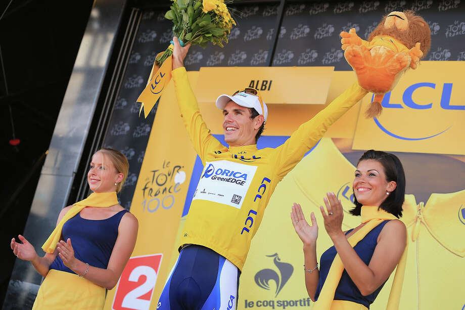 Daryl Impey of South Africa riding for Orica-GreenEDGE takes the podium after defending the overall race leader's yellow jersey in stage seven of the 2013 Tour de France, a 205.5KM road stage from Montpellier to Albi, on July 5, 2013 in Albi, France. Photo: Doug Pensinger, Getty Images / 2013 Getty Images