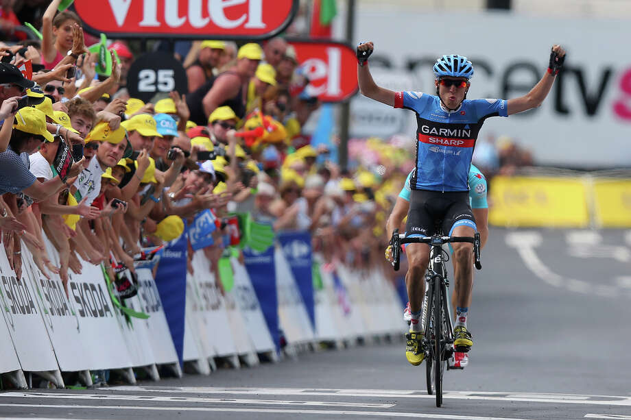 Daniel Martin of Ireland and Team Garmin-Sharp celebrates winning the stage as he crosses the finish line during stage nine of the 2013 Tour de France, a 168.5KM road stage from Saint-Girons to Bagneres-de-Bigorre, on July 7, 2013 in Bagneres-de-Bigorre, France. Photo: Bryn Lennon, Getty Images / 2013 Getty Images