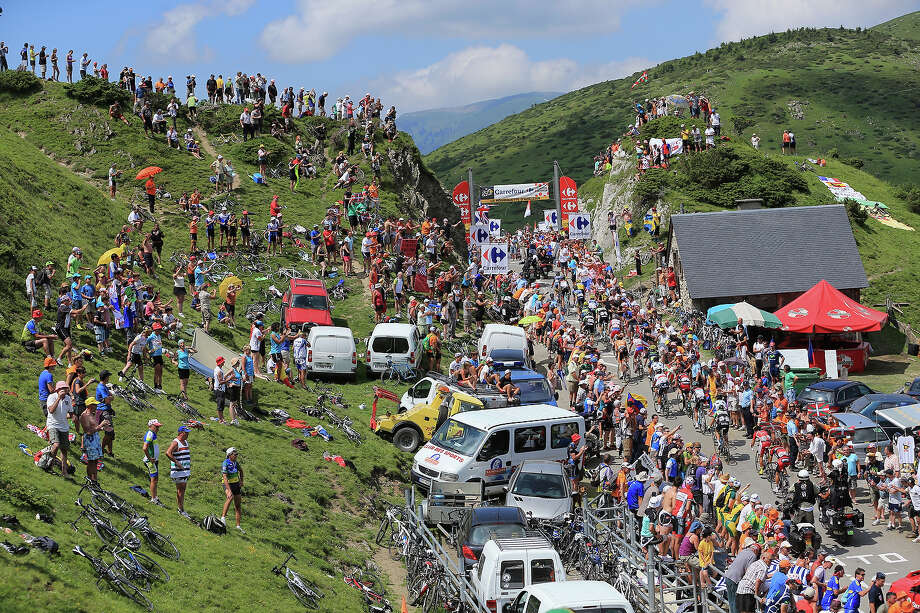 The peloton are cheered on by the crowd as the pass through countryside during stage nine of the 2013 Tour de France, a 168.5KM road stage from Saint-Girons to Bagneres-de-Bigorre, on July 7, 2013 in Bagneres-de-Bigorre, France. Photo: Doug Pensinger, Getty Images / 2013 Getty Images