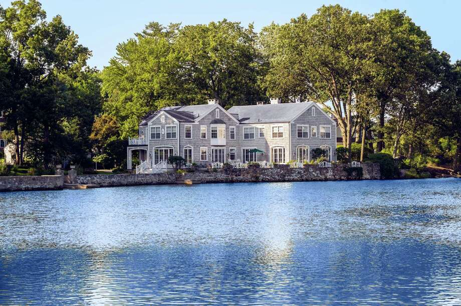 The Colonial at 3 Coves End Road, on the market for $4,495,000, abuts Tokeneke Lagoon with views of Long Island Sound. Photo: Contributed