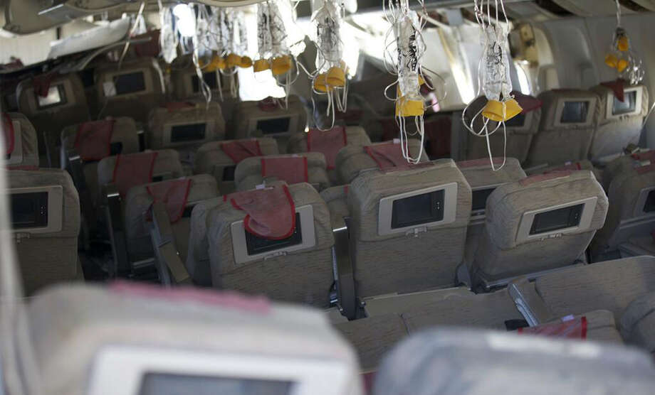 This image released by the National Transportation Safety Board, Sunday, July 7, 2013, shows the interior of the Boeing 777 Asiana Airlines Flight 214 aircraft. The Asiana flight crashed upon landing Saturday, July 6, at San Francisco International Airport, and two of the 307 passengers aboard were killed. (AP Photo/NTSB) Photo: HOPD / NTSB