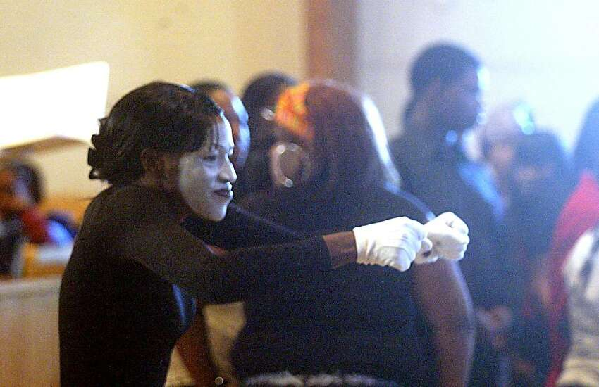 Suzon Johnson performs during the MLK Service at St Paul Missionary Baptist Church. Monday, Jan. 18, 2010