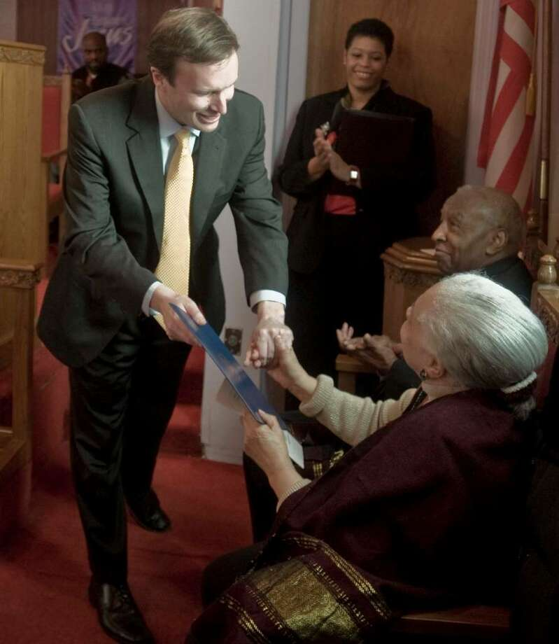 Congressman Chris Murphy presents special guest Marian Stewart with a Congressional Recognition certificate at AME Zion Church during the Martin Luther King Day celebration. Monday, Jan. 18, 2010 Photo: Scott Mullin / The News-Times