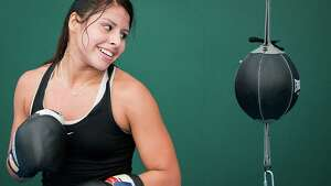 Boxer Marlen Esparza, of Houston,  trains with Team USA on the eve of the Opening Ceremonies for the 2012 London Olympics on Thursday, July 26, 2012. No longer an exclusively male event, women's boxing makes its debut at the Olympics on August 5. Esparza, a flyweight, will step into the ring first for the USA.