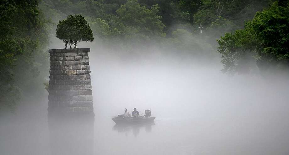 Misty morning:High humidity combined with cooler weather causes a thick fog to smother Boone Lake in Bluff 
