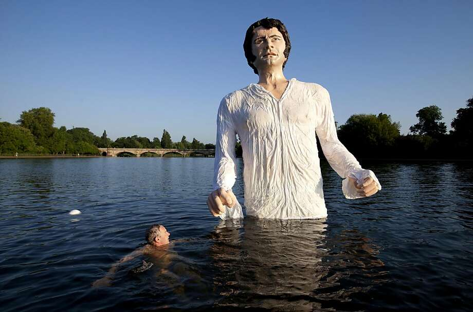 "The pinnacle of British television:The scene in which Colin Firth walks out of a lake in ""Pride And Prejudice"" - depicted by this statue in London's Hyde Park - has been named the most memorable moment in British TV 