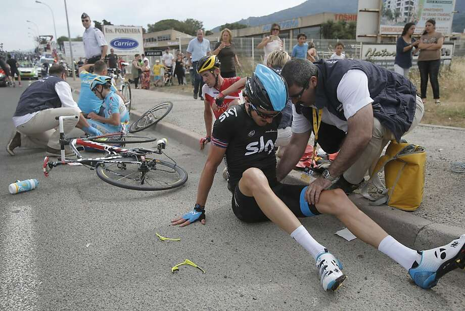 Geraint Thomas of Britain, seen after a crash, fractured his pelvis on the first day of the Tour de France. Photo: Laurent Cipriani, Associated Press