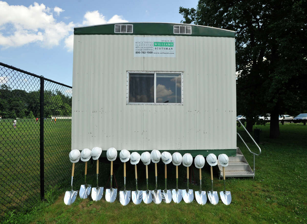 Ceremonial shovels and hard hats await to be used at the music instrumental space and auditorium construction site behind Greenwich High School on Monday, July 8, 2013.