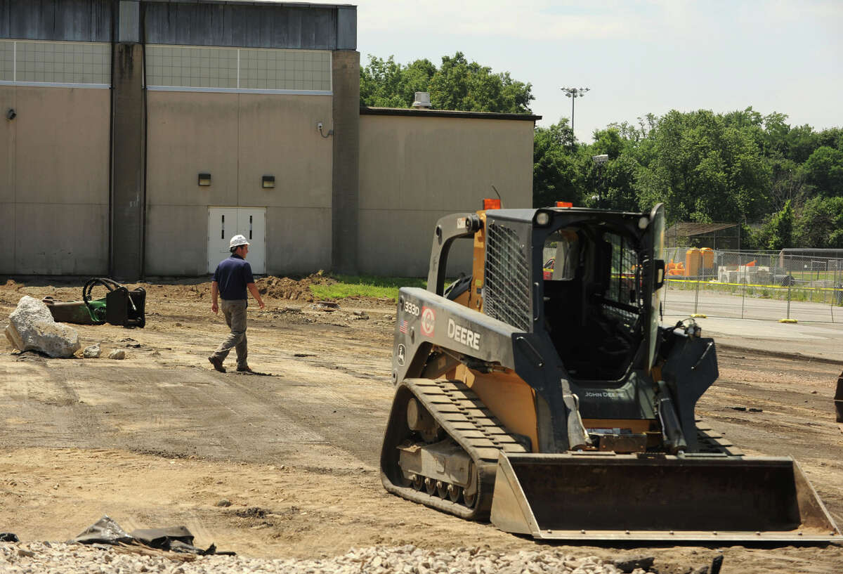 A person walks through the construction area that will become the music instrumental space and auditorium behind Greenwich High School on Monday, July 8, 2013.