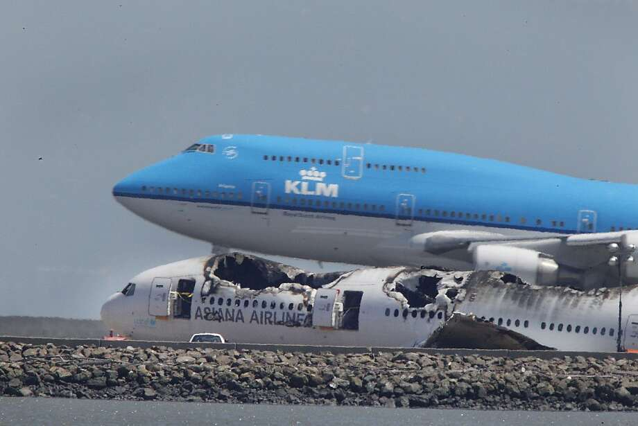 The crashed fuselage of Flight 214 is seen below a KLM flight coming in for a landing on Monday, July 8, 2013 at San Francisco International Airport. Photo: Lea Suzuki, The Chronicle
