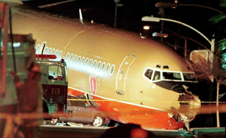 On March 5, 2000, Southwest Airlines flight 1455, a Boeing 737-300, landed in Burbank, Calif., overran the runway, crashed through a metal blast fence and airport perimeter wall and stopped on a city street. During the incident, the forward escape slide inflated inside the airplane, the nose gear collapsed and the forward flight attendant jumpseat partially collapsed, with two flight attendants in it. Photo: Chris Martinez, Getty Images / Getty Images North America