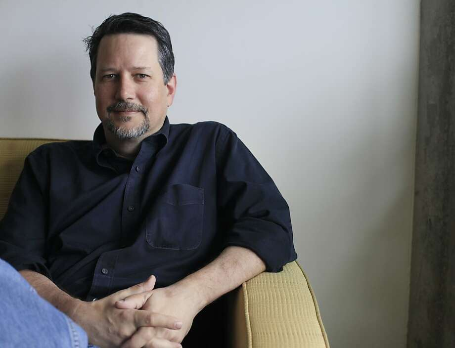 """John Knoll, above, chief creative officer at Industrial Light & Magic, supervises visual effects for """"Pacific Rim,"""" which features robots - that's Gipsy Danger, left - and monsters slugging it out. Photo: Mike Kepka, The Chronicle"""