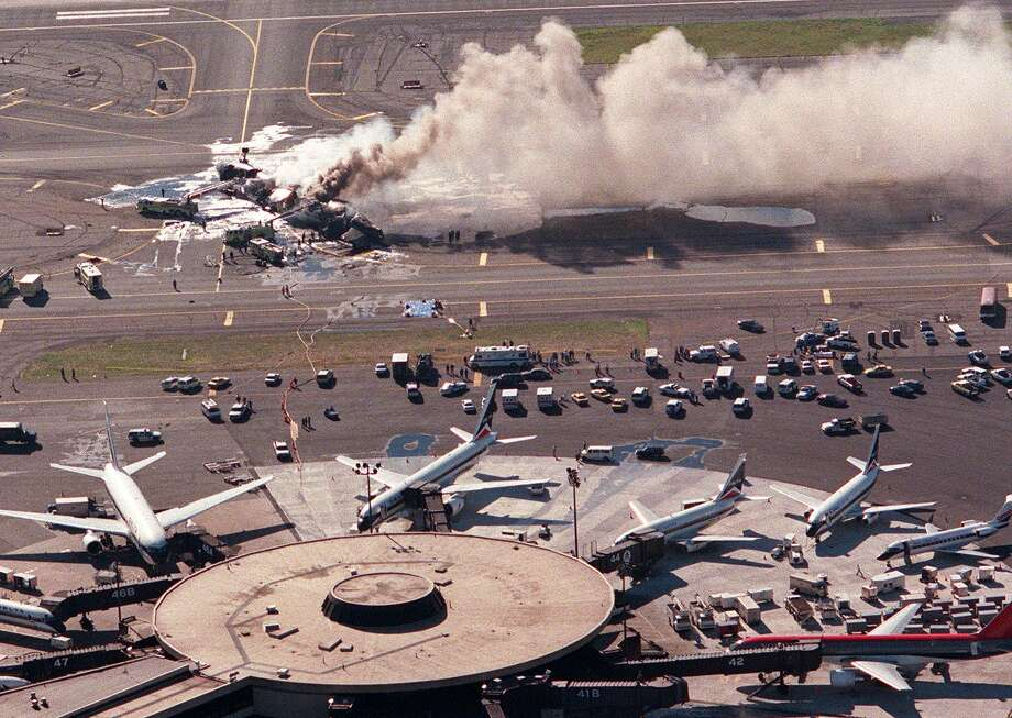 On July 31, 1997, a Federal Express McDonnell Douglas MD-11 landed hard in Newark, N.J., bounced and hit the runway again, causing the right main landing gear to collapse. A fire broke out when the airplane came to a stop. Photo: JON LEVY, AFP/Getty Images / AFP