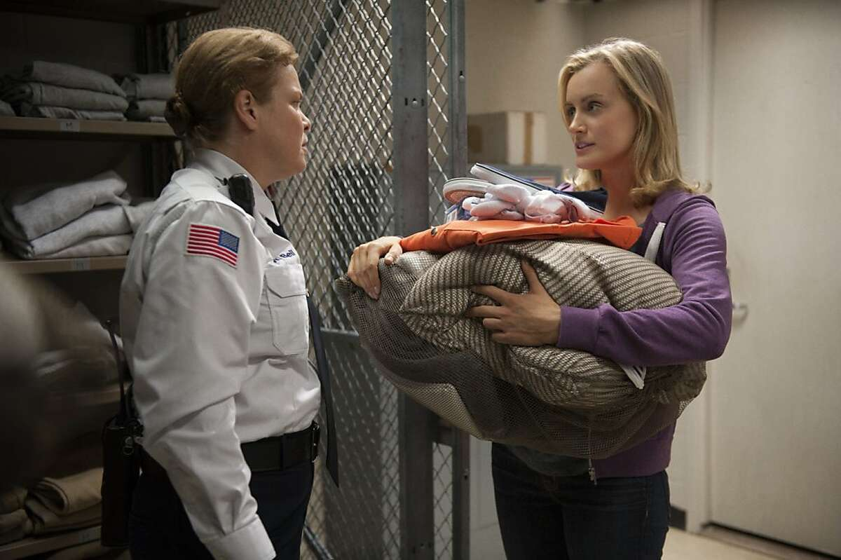 """Catherine Curtin and Taylor Schilling in a scene from Netflix's """"Orange is the New Black."""""""