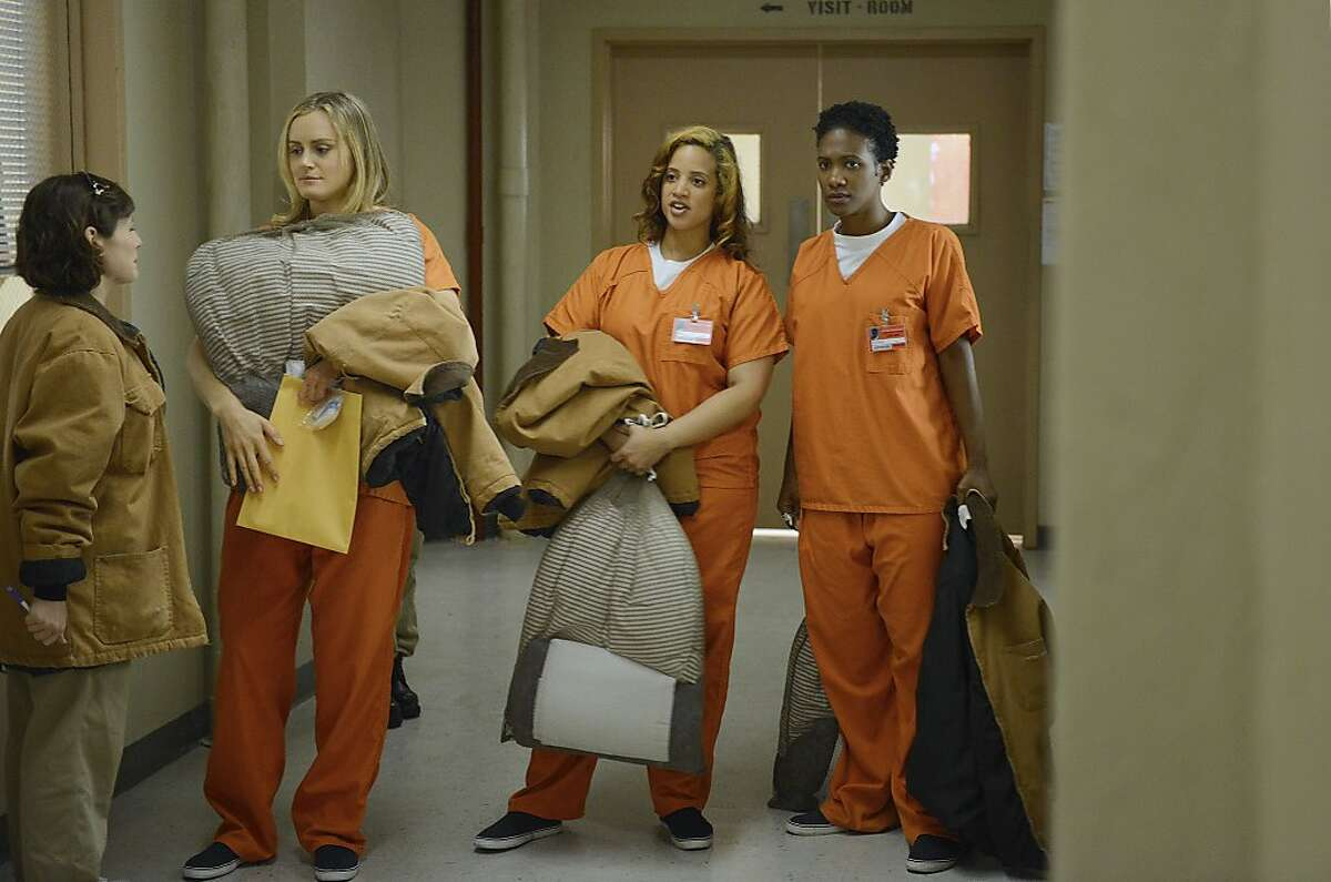 """Yael Stone (L), Taylor Schilling (LC), Dascha Polanco (RC), and Vicky Jeudy (R) in a scene from Netflix?•s ?'Orange is the New Black.?"""""""