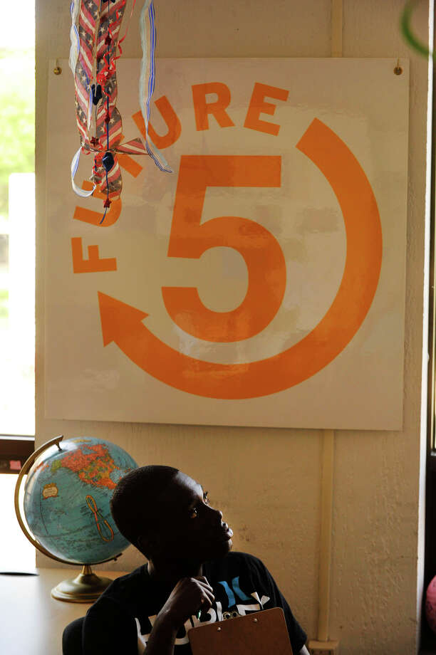 Joshua Cenejuste, 17, listens to a question being asked during Brainwave!, a game of current events knowledge, at Future 5 in Stamford on Monday, July 8, 2013. Future 5 is an academic and job counseling service for teens. Photo: Jason Rearick / Stamford Advocate