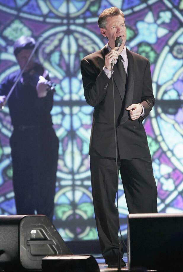 "Travis performs ""Three Wooden Crosses"" during the 35th Annual Gospel Music Awards in Nashville. (Getty Images) Photo: John Russell, Getty Images / 2004 Getty Images"