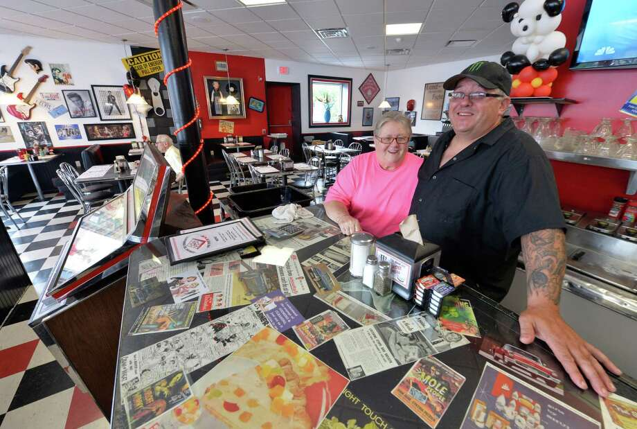 Scotia Diner owners Anita Kyratizis, left, and her son Aristotales Kyratizis, right, at the Scotia Diner, June 26, 2013, in Scotia, N.Y. (Skip Dickstein/Times Union) Photo: Skip Dickstein / 00022988A
