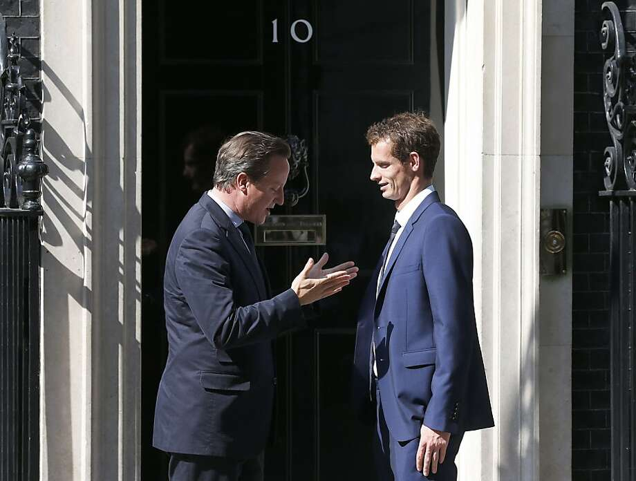 British Prime Minister David Cameron (left) meets Wimbledon winner Andy Murray. Murray is the first English player to win the Wimbledon men's singles title in 77 years. Photo: Frank Augstein, Associated Press