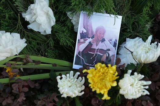 A photograph of 17-year-old Wang Linjia is placed among flowers outside her high school in Jiangshan in China's eastern Zhejiang province on July 8, 2013. Wang Linjia is one of two teenage Chinese girls killed in an Asiana Airlines passenger jet crash at San Francisco airport along with 16 year-old Ye Mengyuan, who were best friends and promising students, state media reported. Photo: Peter Parks, AFP/Getty Images