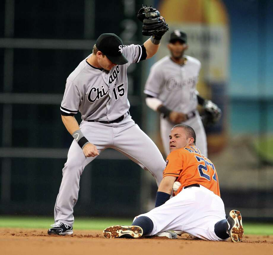 A stolen base by Jose Altuve, right, against the White Sox was one of 21 on the season for the Astros second baseman. Photo: Karen Warren, Staff / © 2013 Houston Chronicle