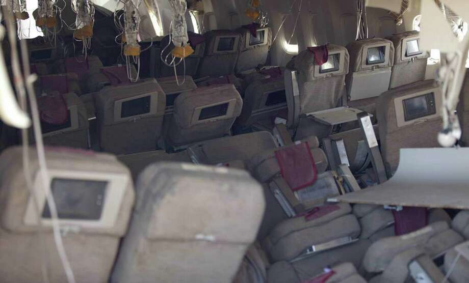 A National Transportation Safety Board image shows an interior view of Asiana Flight 214 in San Francisco during their first site assessment by the agency. Photo: HO, Handout / AFP