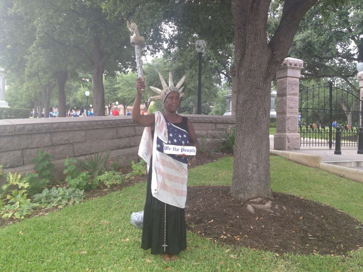 Peace Washington Constanzo protesting silently at Congress Avenue in Austin on July 8, 2013.