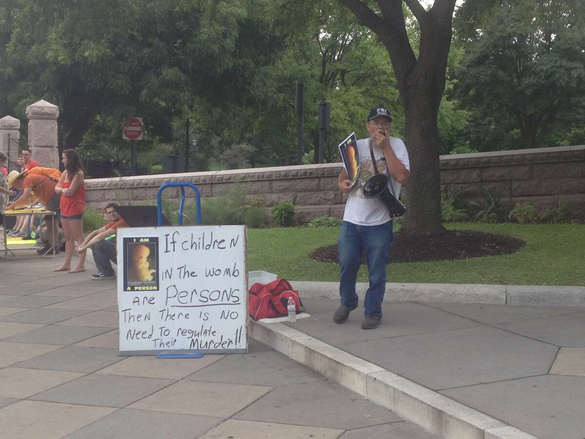 Rick Ellis protests in front of the Capitol in Austin along Congress Avenue on July 8, 2013.