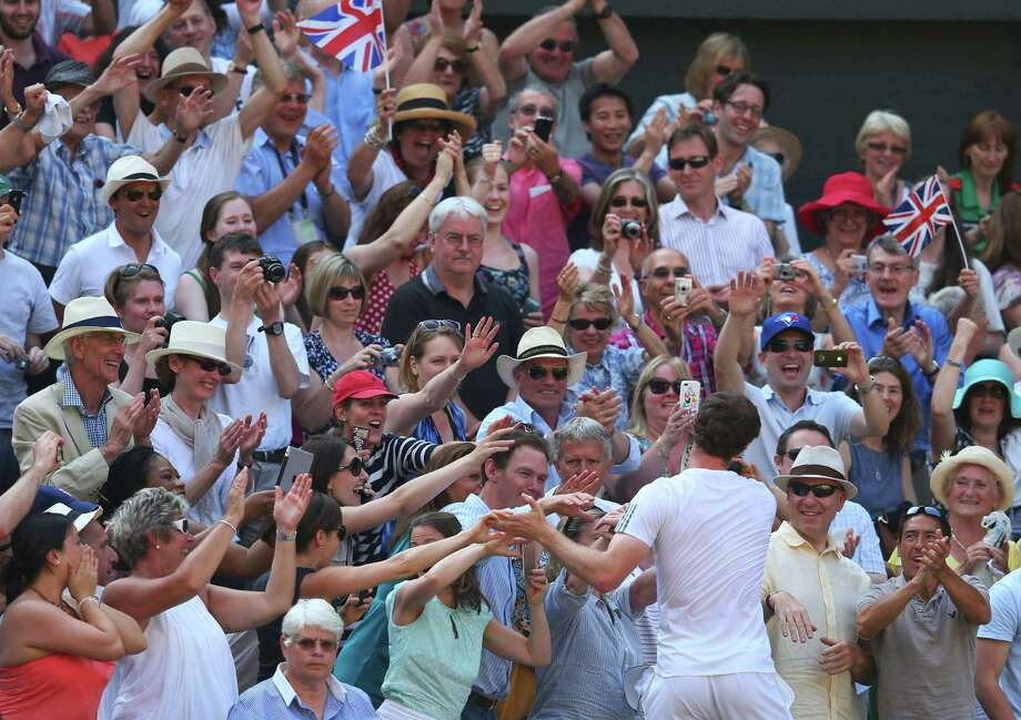 Andy Murray's popularity in Great Britain is off the charts after his historic victory in Sunday's Wimbledon final. Photo: Julian Finney, Staff / 2013 Getty Images