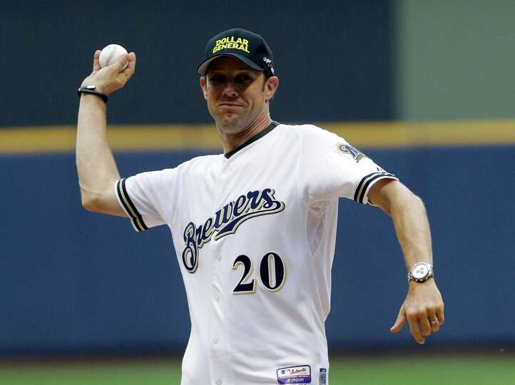 NASCAR driver Matt Kenseth throws out a ceremonial first pitch before a baseball game between the Mi
