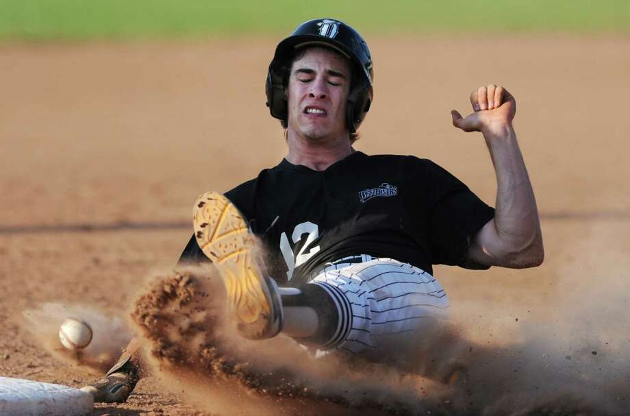 Danbury's Daniel Spingola slides safely into third base during the Danbury Westerners' NECBL baseball game against the Holyoke Blue Sox at Rogers Park in Danbury, Conn. on Monday, July 8, 2013. Photo: Tyler Sizemore / The News-Times