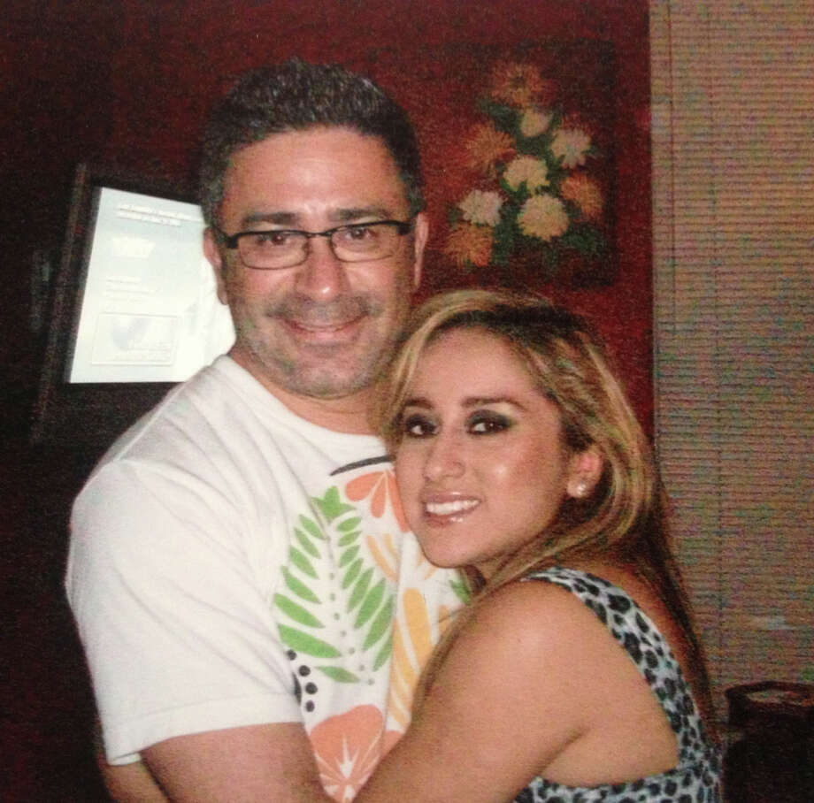 Alisha Rojano, 24, hugs her father, Joe Gamez, 44, for a family photo. Gamez was killed Saturday morning while bike riding with his family downtown. Photo: Courtesy Family