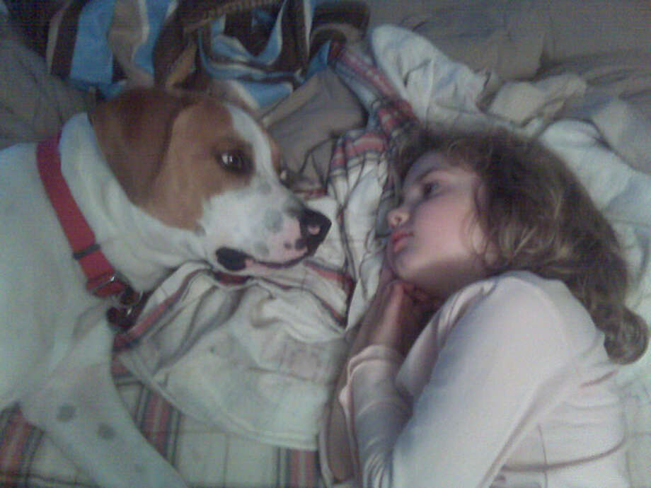 Buddies 8-year-old Jenna Sweet and 5-year-old Jack take a rest at their Albany home. (Mark Sweet)