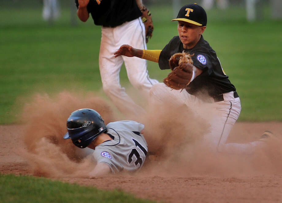 Wilton's Brendan Skewis steals second base ahead of the tag of Trumbull second baseman Dustin Sigueira in the 5th inning of their Babe Ruth championship matchup at Unity Park in Trumbull, Conn on Monday, July 8, 2013. Wilton won the game 3-1. The two teams will match up again on Tuesday to decide the title. Photo: Brian A. Pounds / Connecticut Post