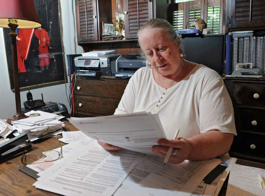Mary Ann Morgan, a professional tax preparer since 1974, works in her home office on Monday, July 8, 2013, in Ballston Spa, N.Y. Her clients who filed with paper returns for the 2012 tax year have to receive their refund checks. (Lori Van Buren / Times Union) Photo: Lori Van Buren / 00023090A