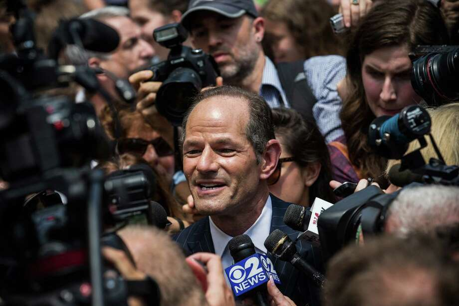 NEW YORK, NY - JULY 08:  Former New York Gov. Eliot Spitzer is mobbed by reporters while attempting to collect signatures to run for comptroller of New York City on July 8, 2013 in New York City. Spitzer resigned as governor in 2008 after it was discovered that he was using a high end call girl service.  (Photo by Andrew Burton/Getty Images) ORG XMIT: 173275042 Photo: Andrew Burton / 2013 Getty Images
