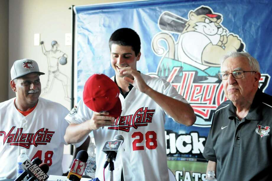 Mark Appel, center, is introduced as a pitcher for the Tri-City ValleyCats Thursday afternoon, July 4, 2013, during a press conference at Joe Bruno Stadium in Troy, N.Y.  Appel was the first round draft pick for Houston. Hea€™ll pitch for the ValleyCats starting Friday night. Ed Romero, ValleyCats manager, left, and club president Bill Gladstone, right, welcomed him to the team. Will Waldron/Times Union) Photo: WILL WALDRON / 00023058A