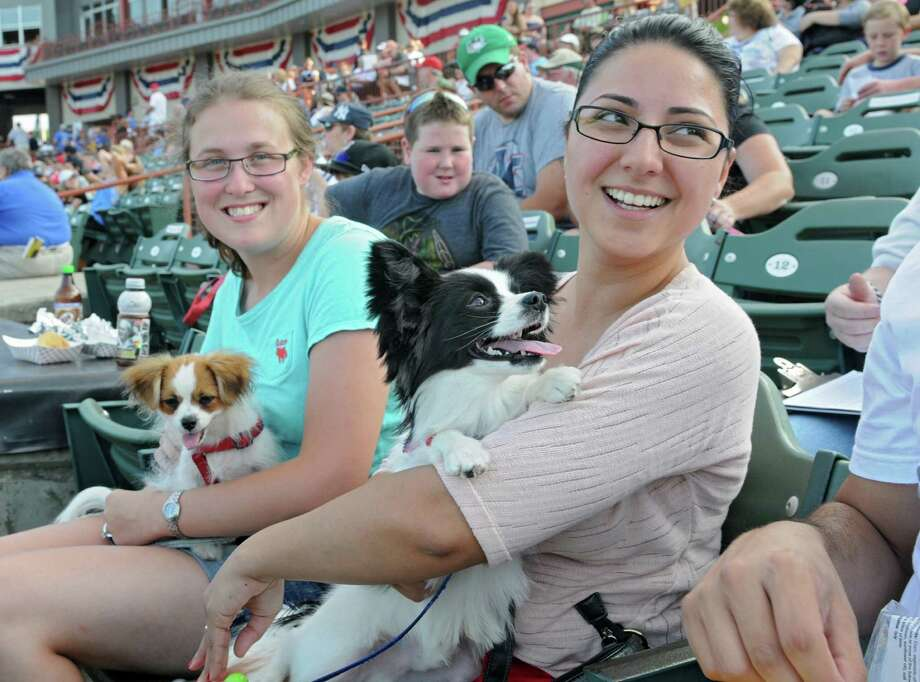 "Jess Olson and her dog Eddie of Stephentown and Sheila Carattini and her dog Apollo of Rensselaer enjoy ""Bark in the Park Night"" at a Tri-City ValleyCats game against Aberdeen at Bruno Stadium on Monday, July 8, 2013 in Troy, N.Y. (Lori Van Buren / Times Union) Photo: Lori Van Buren / 00023063A"