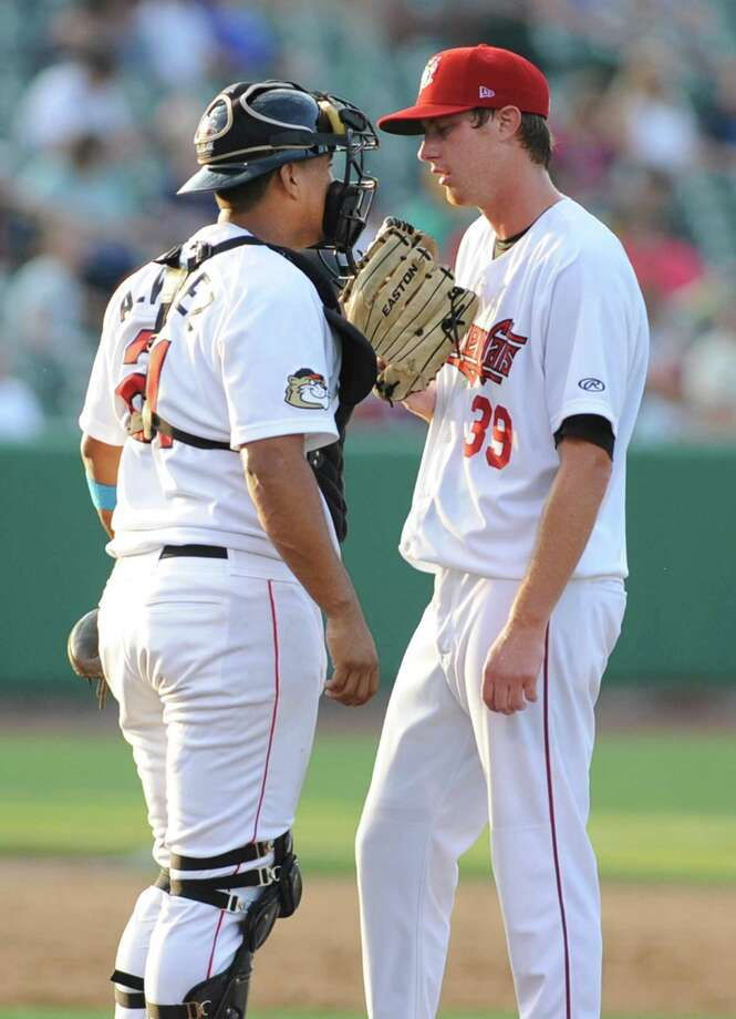 Tri-City ValleyCats catcher Luis Alvarez talks to pitcher Randall Fant on the mound during a game against Aberdeen at Bruno Stadium on Monday, July 8, 2013 in Troy, N.Y. (Lori Van Buren / Times Union) Photo: Lori Van Buren / 00023063A