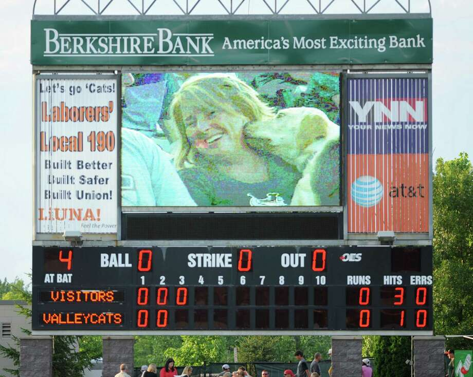 "A woman's dog gives her a kiss and is caught on the scoreboard screen during ""Bark in the Park Night"" at a Tri-City ValleyCats game against Aberdeen at Bruno Stadium on Monday, July 8, 2013 in Troy, N.Y. (Lori Van Buren / Times Union) Photo: Lori Van Buren / 00023063A"