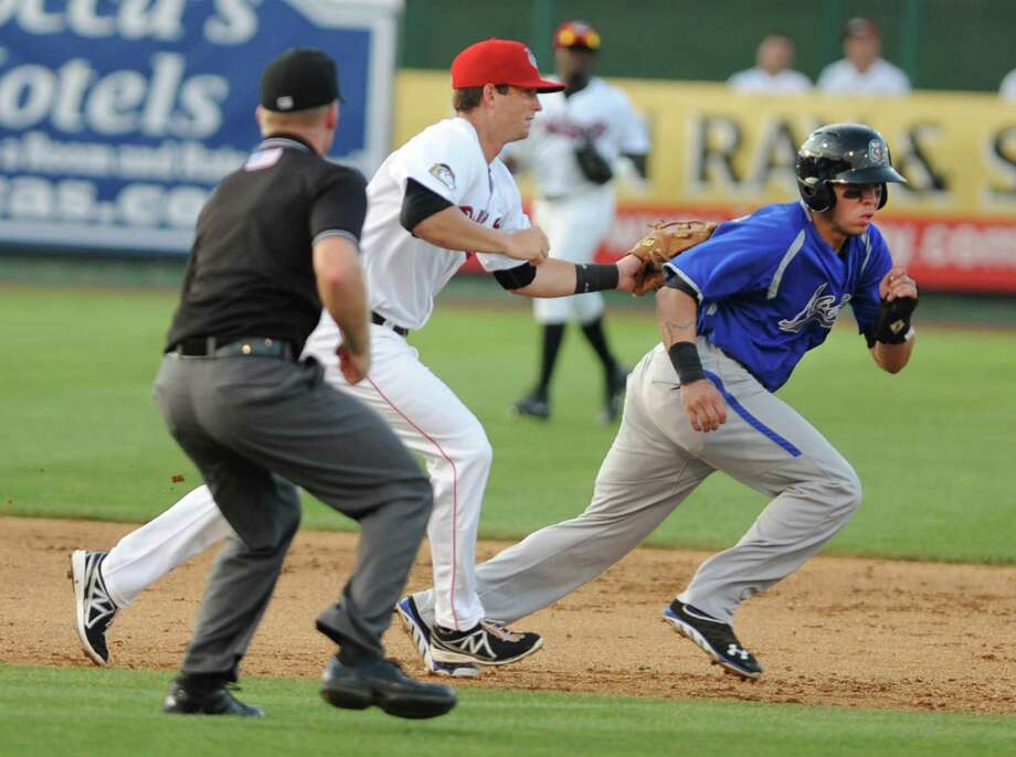 Tri-City ValleyCats third baseman Ryan Dineen tags out Aberdeen's base runner Manny Hernandez in a pickle during a game at Bruno Stadium on Monday, July 8, 2013 in Troy, N.Y. (Lori Van Buren / Times Union) Photo: Lori Van Buren / 00023063A