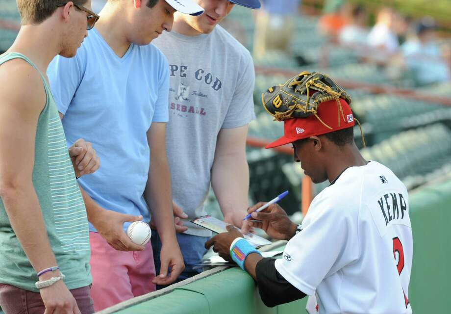 Tri-City ValleyCat's Tony Kemp signs autographs for fans before a game against Aberdeen at Bruno Stadium on Monday, July 8, 2013 in Troy, N.Y. (Lori Van Buren / Times Union) Photo: Lori Van Buren / 00023063A