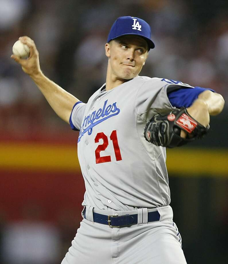 Zack Greinke got more hits than he allowed as the Dodgers routed Arizona 6-1 in Phoenix on Monday night to move 3 1/2 games off the NL West lead. Photo: Rick Scuteri, Associated Press