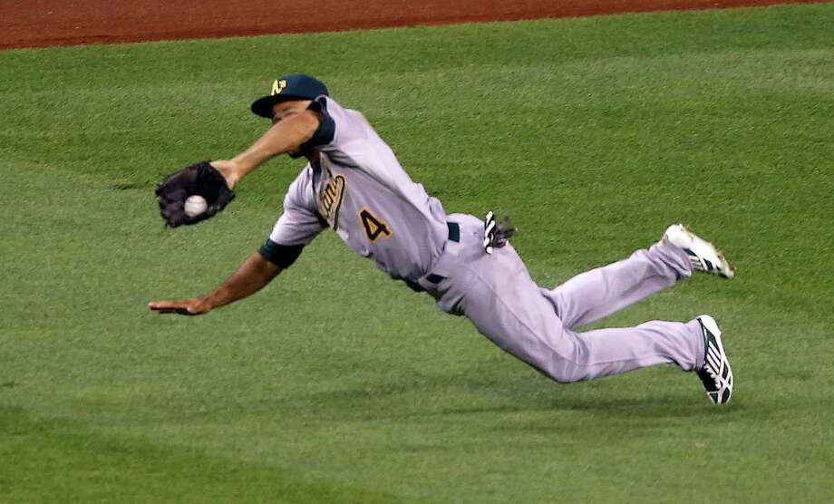Athletics center fielder Coco Crisp makes a key defensive play, taking a hit away from the Pirates' Andrew McCutchen and stranding a runner at second in the seventh inning of Oakland's 2-1 victory. Photo: Keith Srakocic, STF / AP