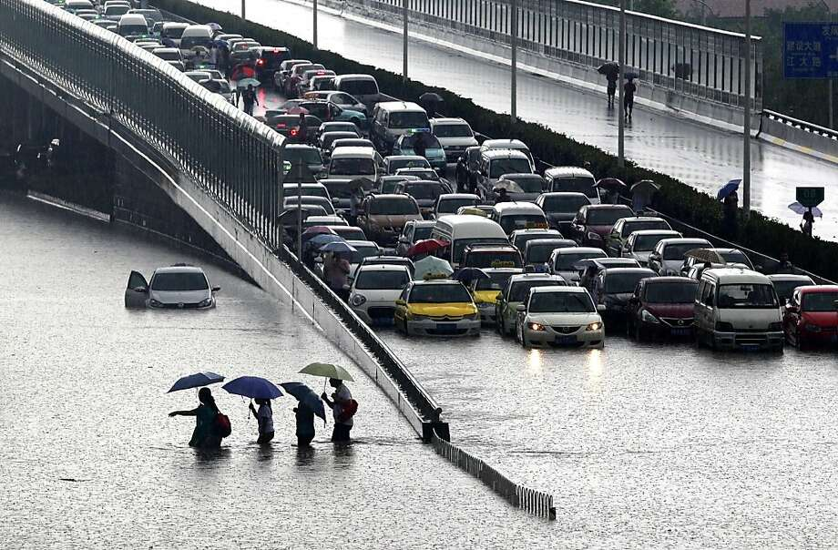 Can't go forward, can't turn around, so some stranded motorists in a flooded section of Wuhan, China, decide to wade it out. Photo: Stringer, AFP/Getty Images