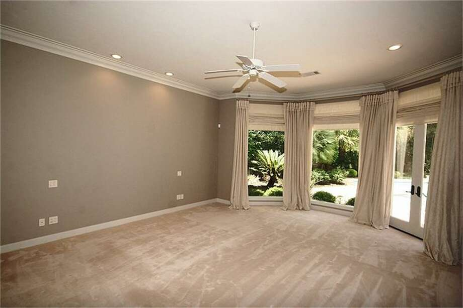 This additional bedroom offers views of the outer grounds.