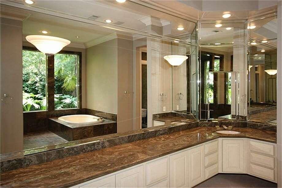 The master bathroom has granite countertops and dual vanity sinks.
