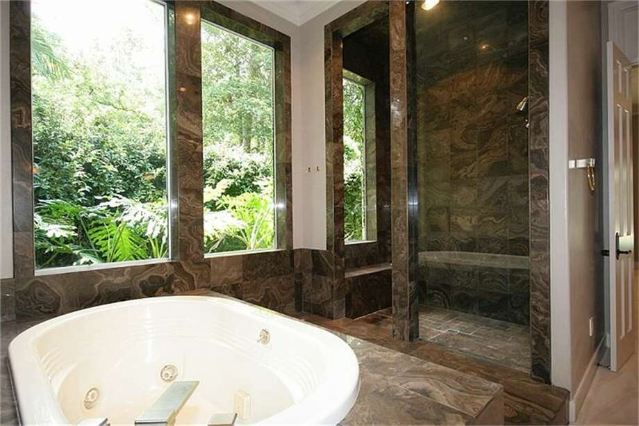 The master bathroom has a whirlpool tub and separate shower.