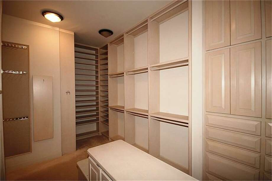 A large, walk-in closet offers plenty of space for a wardrobe.