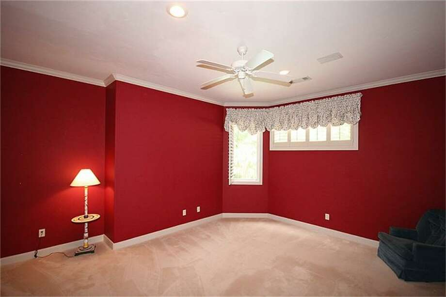 A bonus room can be used as a guest room or cozy family room.